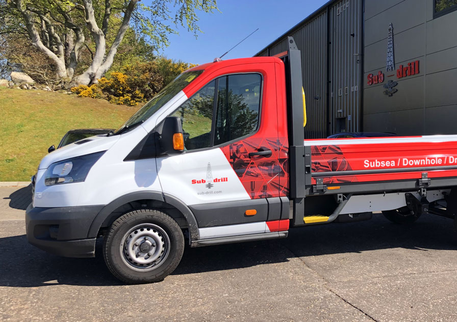vehicle branding on dropside truck